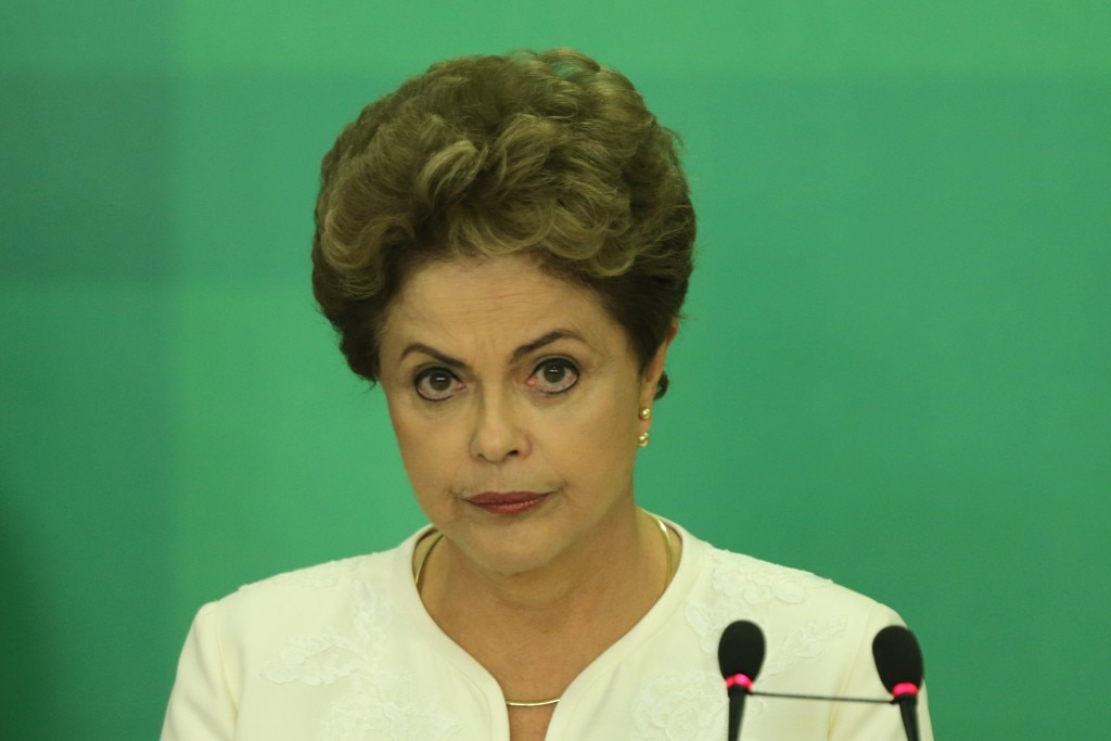 Brazil's President Dilma Rousseff reacts during a press conference after impeachment proceedings were opened against her by the President of Chamber of Deputies Eduardo Cunha, at the Planalto Presidential Palace in Brasilia, Brazil, Wednesday, Dec. 2, 2015. The speaker of the nation's lower house says he's opening the impeachment process based on accusations that Rousseff's government broke fiscal responsibility laws this year. (AP Photo/Eraldo Peres)