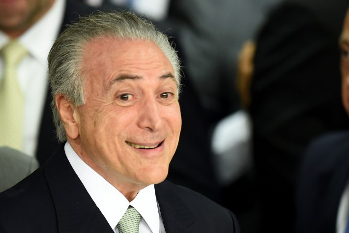 CORRECTION - Brazilian acting President Michel Temer (R) gestures during the inauguration ceremony of the new ministers at Planalto Palace, in Brasilia, on May 12, 2016. Brazilian President Dilma Rousseff was suspended Thursday to face an impeachment trial, ceding power to her vice president-turned-enemy Michel Temer, who quickly pivoted toward a more business-friendly government, naming a cabinet chosen to calm the markets after a paralyzing impeachment battle and steer the country out of its worst recession in decades. / AFP PHOTO / EVARISTO SA / ?The erroneous mention[s] appearing in the metadata of this photo by MARCOS CORREA has been modified in AFP systems in the following manner: [EVARISOT SA] instead of [MARCOS CORREA] on byline. And Source AFP instead of BRAZILIAN VICE PRESIDENCY. Please immediately remove the erroneous mention[s] from all your online services and delete it (them) from your servers. If you have been authorized by AFP to distribute it (them) to third parties, please ensure that the same actions are carried out by them. Failure to promptly comply with these instructions will entail liability on your part for any continued or post notification usage. Therefore we thank you very much for all your attention and prompt action. We are sorry for the inconvenience this notification may cause and remain at your disposal for any further information you may require.?
