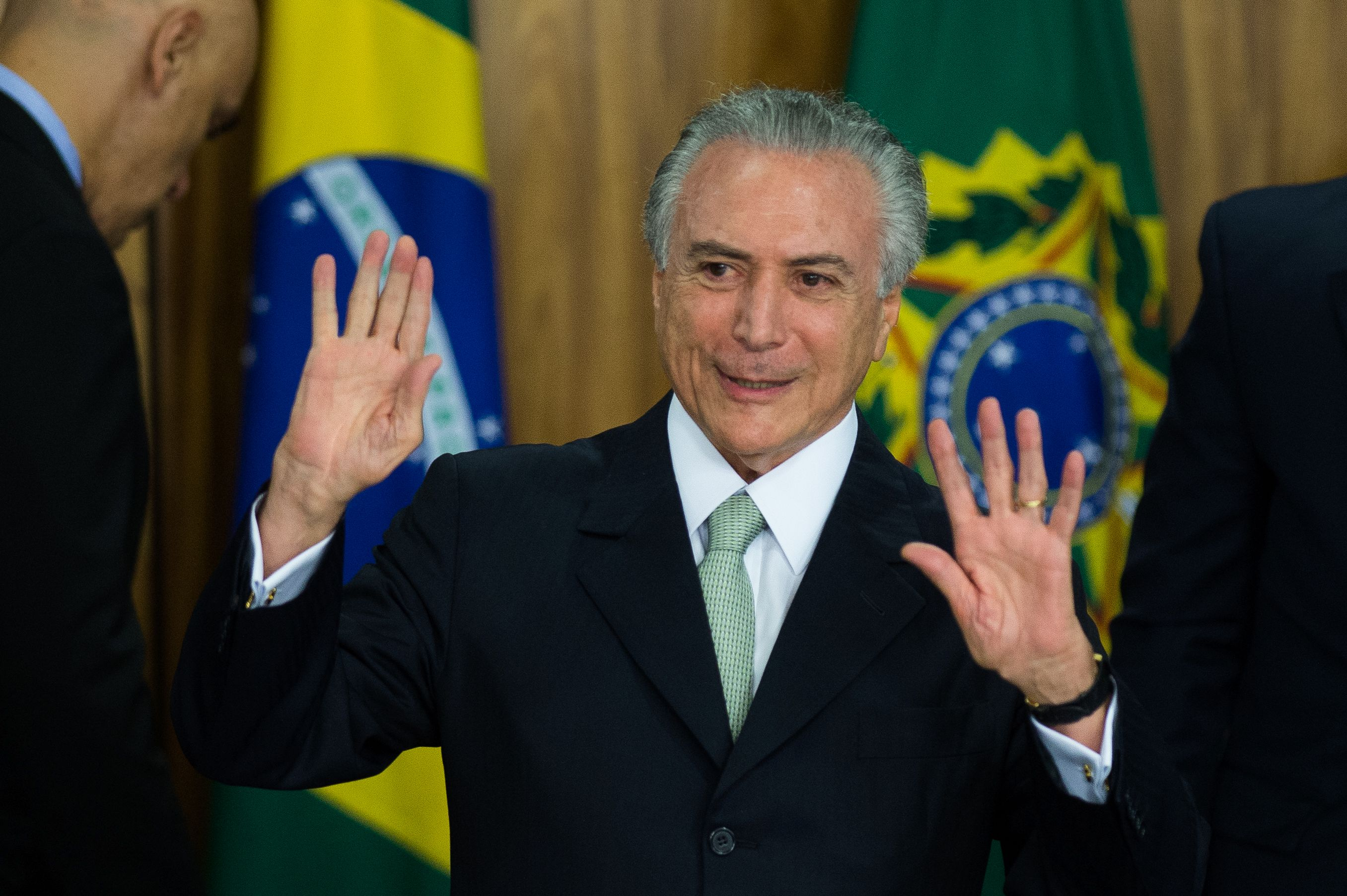 Brazilian acting president Michel Temer gestures during his new ministers' inauguration ceremony at Planalto palace in Brasilia, on May 12, 2016. Temer said Thursday his new cabinet must work to restore the country's