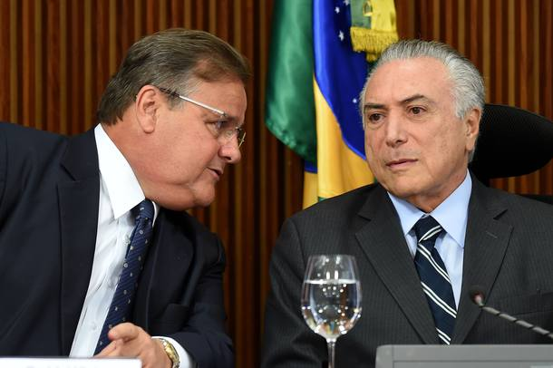(FILES) This file photo taken on June 15, 2016 shows then Brazilian acting President Michel Temer (R) and the General Secretary of the Brazilian Presidency Geddel Vieira Lima speaking during a meeting with party leaders of the National Congress at Planalto Palace in Brasilia. Vieira Lima resigned on November 25, 2016 amid a political crisis in Brazil. Brazilian President Michel Temer denied Thursday having