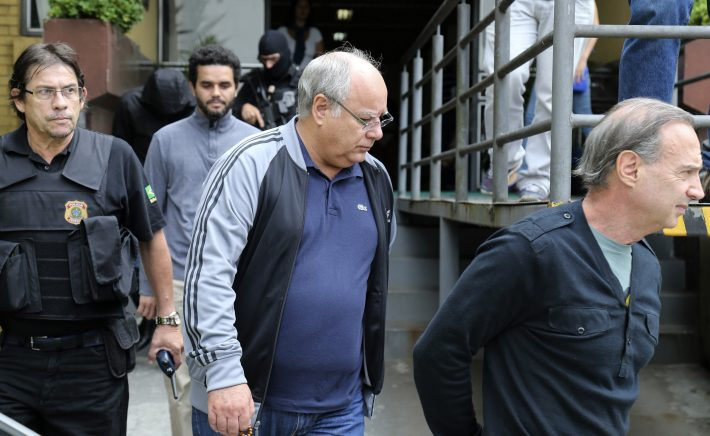 Adir Assad, Lucelio Goes and former Petrobras executive, Renato Duque are escorted by Federal Police as they leave the Institute of Forensic Science in Curitiba