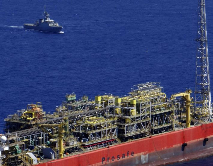 The Cidade de Sao Mateus, a floating production, storage and offloading (FPSO) ship that was contracted to Petrobras is pictured in Sao Mateus in Espirito Santo state in this February 12, 2015 handout picture provided by the Brazilian Navy. Five people were killed and four are missing following an explosion a day earlier in a Brazilian offshore oil and natural gas field run by Petroleo Brasileiro SA (Petrobras), said Norway's BW Offshore Ltd, which owns the production ship on which the accident occurred. The explosion occurred after a natural gas leak on the Cidade de Sao Mateus. REUTERS/Brazilian Navy/Handout via Reuters (BRAZIL - Tags: ENERGY BUSINESS DISASTER MARITIME) ATTENTION EDITORS - THIS PICTURE WAS PROVIDED BY A THIRD PARTY. REUTERS IS UNABLE TO INDEPENDENTLY VERIFY THE AUTHENTICITY, CONTENT, LOCATION OR DATE OF THIS IMAGE. THIS PICTURE IS DISTRIBUTED EXACTLY AS RECEIVED BY REUTERS, AS A SERVICE TO CLIENTS. FOR EDITORIAL USE ONLY. NOT FOR SALE FOR MARKETING OR ADVERTISING CAMPAIGNS. NO SALES. NO ARCHIVES