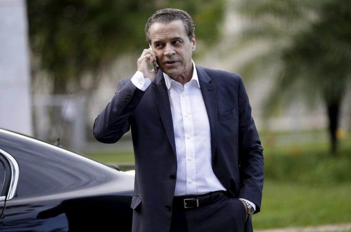 Brazilian Minister of Tourism Henrique Eduardo Alves talks on his mobile phone after a meeting with Brazil's Vice President Michel Temer (not pictured) in Brasilia, Brazil, December 14, 2015. Picture taken December 14, 2015. REUTERS/Ueslei Marcelino