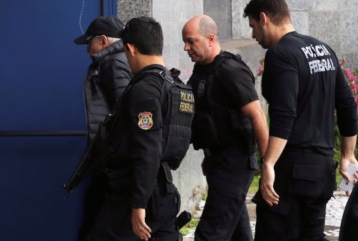Brazil's former Finance Minister Guido Mantega (L) is escorted by federal police officers as he arrives at the Federal Police headquarters in Sao Paulo, Brazil, September 22, 2016. REUTERS/Nacho Doce