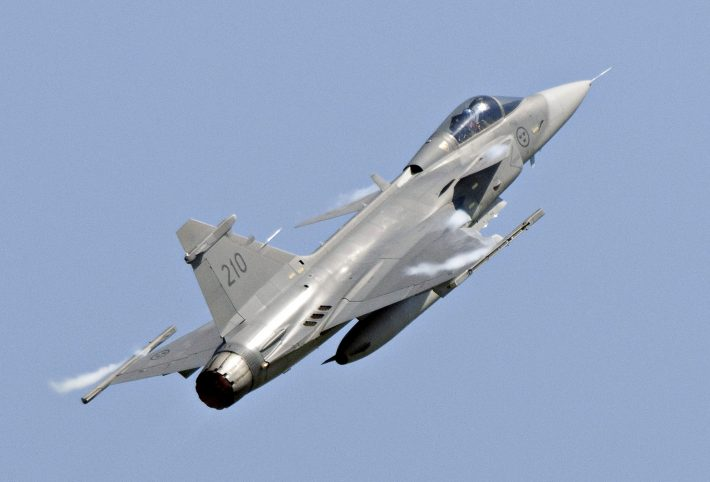 A Saab JAS 39C Gripen jet performs during an aerial show in Eslov in this June 5, 2011 file photo. Brazil on December 18, 2013 awarded a $4.5 billion contract to Saab AB to replace its aging fleet of fighter jets, a surprise coup for the Swedish company after news of U.S. spying on Brazilians helped derail Boeing's chances for the deal. The contract, negotiated over the course of three consecutive Brazilian presidencies, will supply Brazil's air force with 36 new Gripen NG fighters through 2023. Aside from the cost of the jets themselves, the agreement is also expected to generate billions of additional dollars in future supply and service contracts. REUTERS/Johan Nilsson/TT News Agency/Files (SWEDEN - Tags: TRANSPORT MILITARY BUSINESS) ATTENTION EDITORS - THIS IMAGE HAS BEEN SUPPLIED BY A THIRD PARTY. IT IS DISTRIBUTED, EXACTLY AS RECEIVED BY REUTERS, AS A SERVICE TO CLIENTS. SWEDEN OUT. NO COMMERCIAL OR EDITORIAL SALES IN SWEDEN