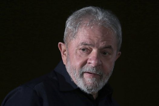 In this March 13, 2017 photo, Brazil's former President Luiz Inacio Lula da Silva arrives for an event with rural workers in Brasilia, Brazil. Brazil's former president has denied in court on March 14, that he was part of a plot to obstruct a massive corruption probe by keeping a former executive-turned-state's evidence from revealing what he knew. (AP Photo/Eraldo Peres)